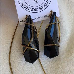 Black earrings wrapped in brass beltshazzar